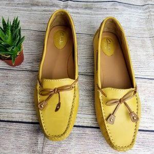 Clark's artisan mustard yellow leather loafers